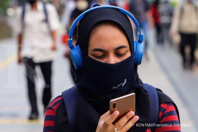 Masker kain efektif menangkal serangan Virus Corona. KONTAN/Fransiskus Simbolon