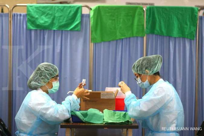 Taiwan to quarantine workers to control COVID spike at tech firm