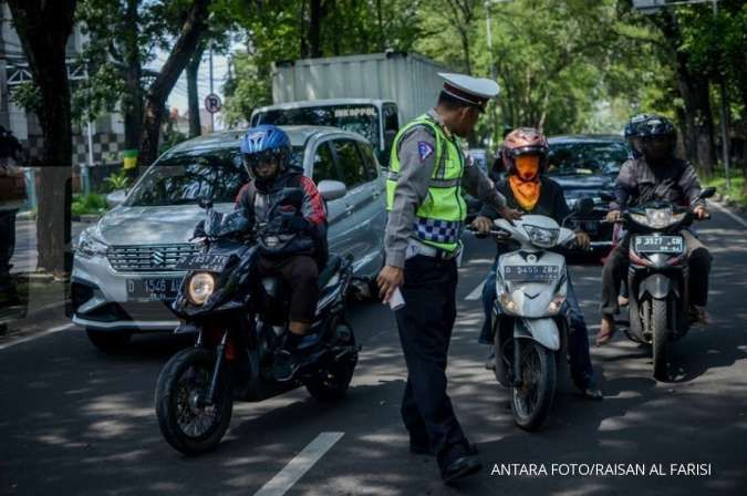 Ingat ya! Bonceng dua penumpang di sepeda motor bakal kena denda Rp 250.000