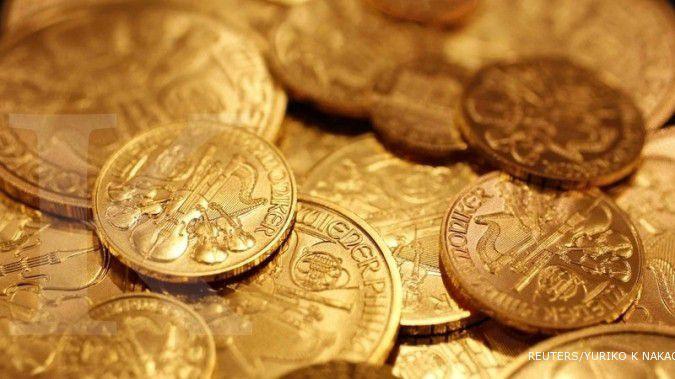 Emas semakin berpendar setelah risalah The Fed