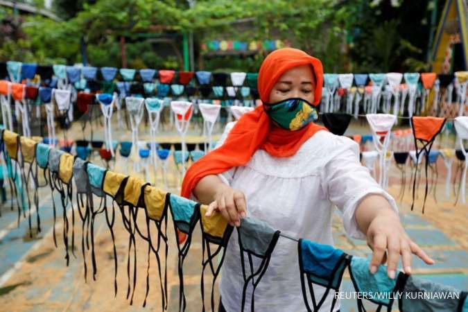 Begini cara memakai dan merawat masker kain, menurut WHO