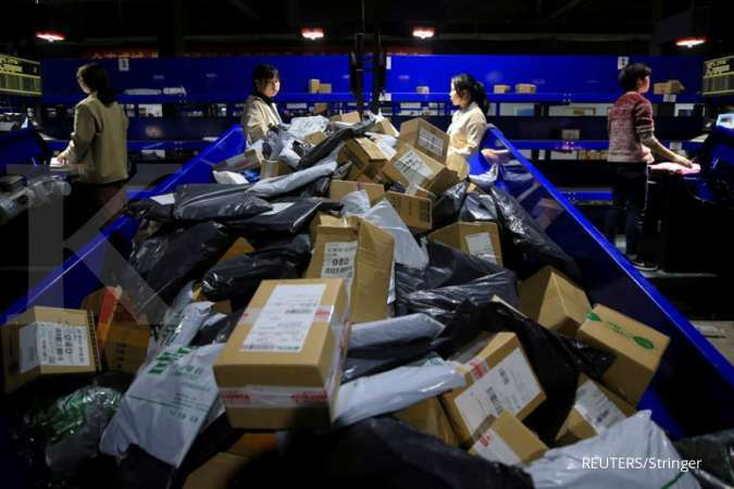 Workers sort parcels at a China Post logistics centre after the 11.11 Singles' Day shopping festival in Hengyang, Hunan province, China early November 12, 2019.