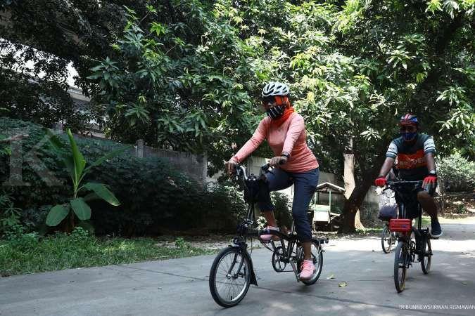 Menggunakan masker saat bersepeda atau lari punya manfaat, lo, ini penjelasannya